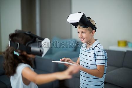 siblings using virtual reality headset and
