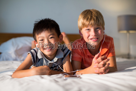 portrait of siblings listening to music