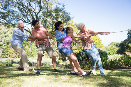 family playing tug of war in