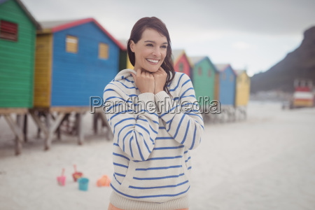 smiling woman standing at beach