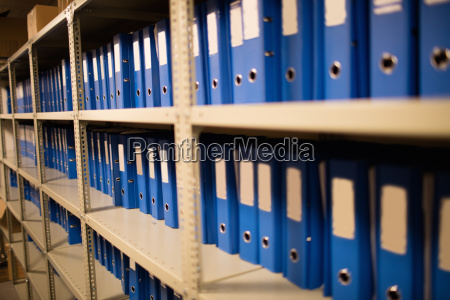 blue files on shelves in storage