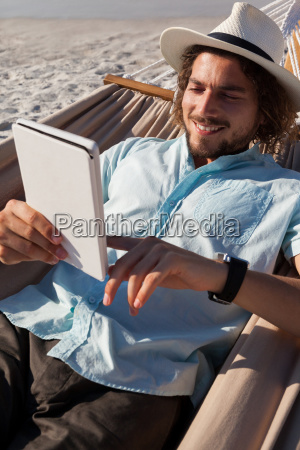 man, relaxing, on, hammock, and, using - 23071811