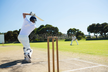 rear view of player batting while