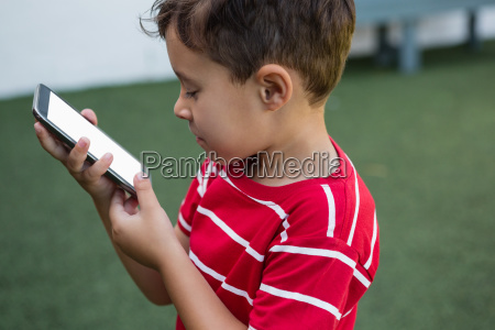 side view of boy using smart