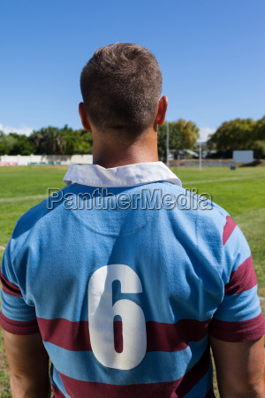 rear view of rugby player standing