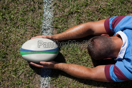 rear view of rugby player holding