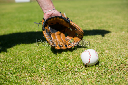 hand of baseball pitcher by ball