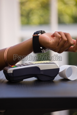 hand of customer making payment via