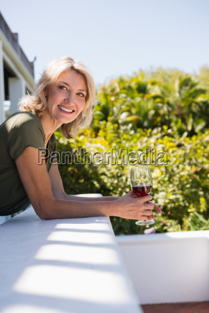 mid adult woman with red wine