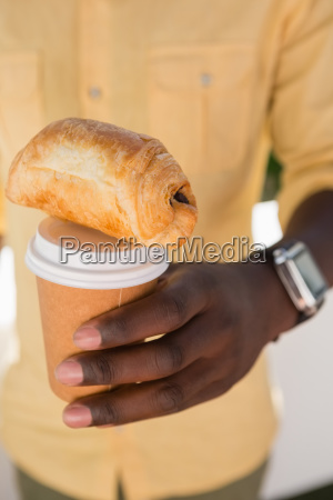 mid section of man holding coffee