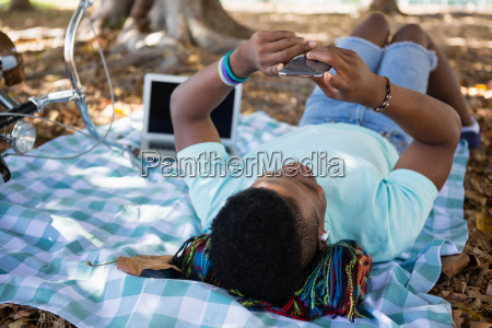 young man using mobile phone while