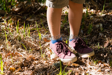 boy in shoes standing in the