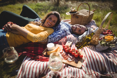 portrait of happy young couple lying
