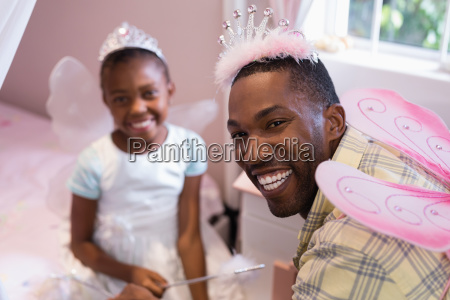 cheerful father and daughter wearing costume