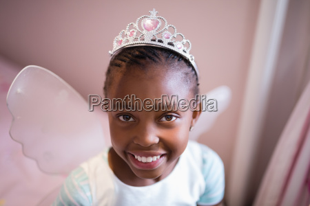 portrait of smiling girl wearing fairy