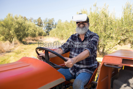 happy man using virtual reality headset