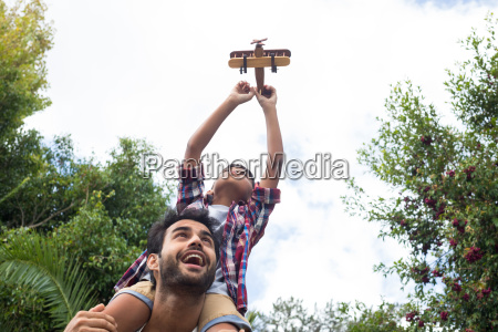 low angle view of father carrying