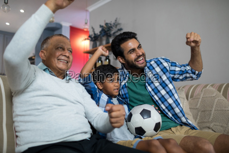 happy family with arms raised watching
