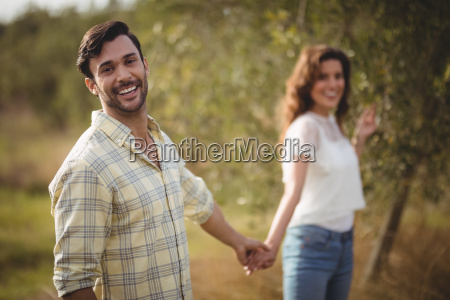handsome young man holding woman at