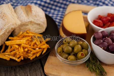 french fries with bread by olives