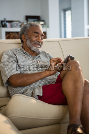 senior man using mobile phone in