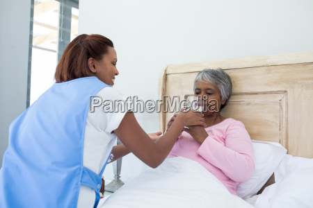 female doctor giving glass of water
