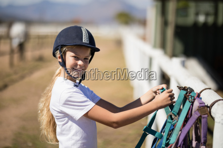 smiling girl picking up a horse