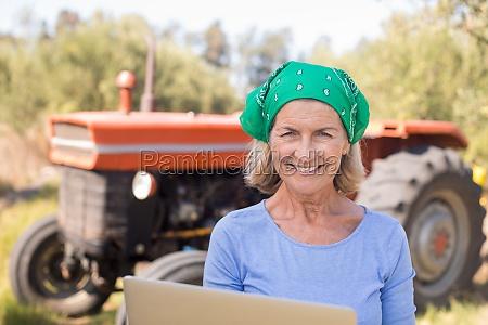 portrait of happy woman using laptop