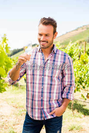 smiling handsome man holding wineglass
