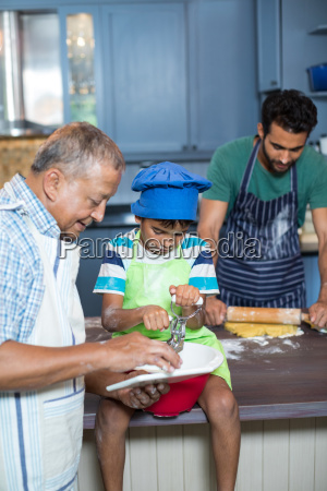 grandfather showing tablet computer to boy
