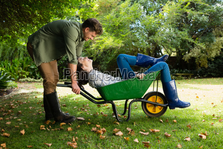 man interacting with woman while pushing