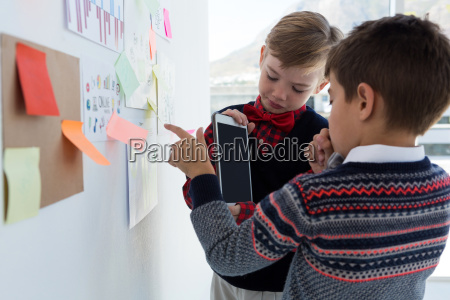 kids as business executives discussing over
