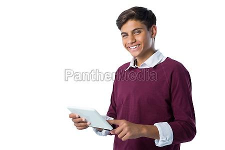 teenage boy using digital tablet against