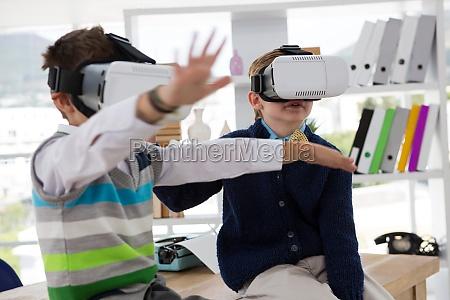 kids as business executives using virtual