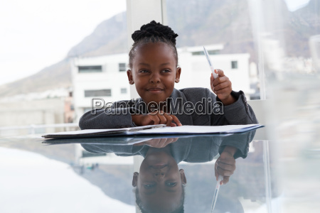 smiling businesswoman with document looking away