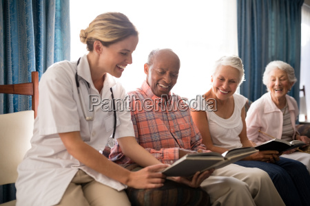 smiling female doctor reading book to