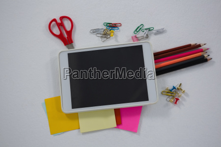 various school supplies and digital tablet