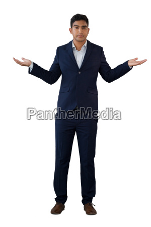 portrait of businessman gesturing while wearing