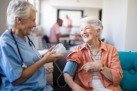 smiling senior woman talking to female