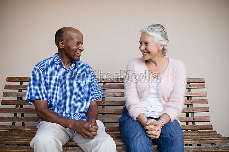 smiling senior man and woman looking