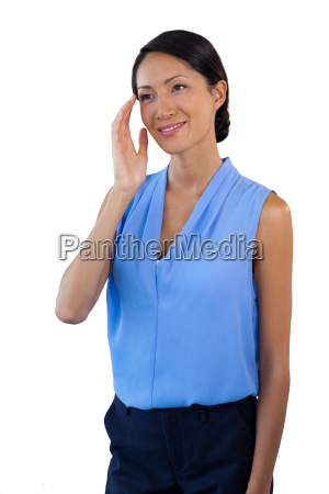 smiling thoughtful businesswoman looking away while