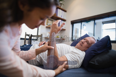 senior male patient looking at female