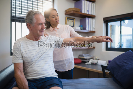 female doctor and senior male patient