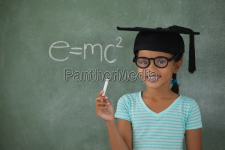young girl with graduation hat holding