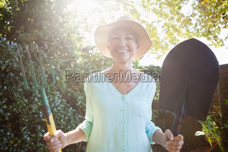 back lit portrait of smiling senior
