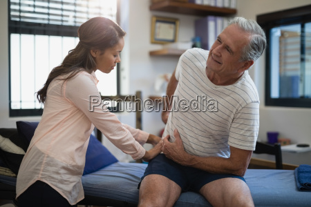 senior male patient sitting on bed