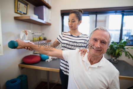 female doctor holding hand of smiling