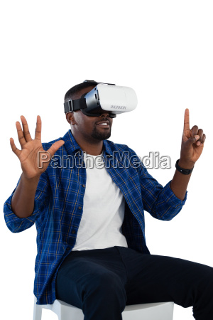 man gesturing while using virtual reality