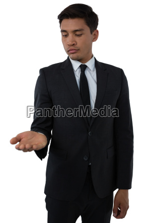 young businessman looking at palm of