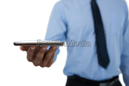 mid section of businessman holding digital